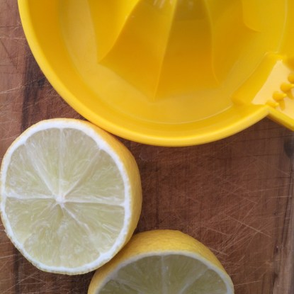 Juicing the lemons and limes.