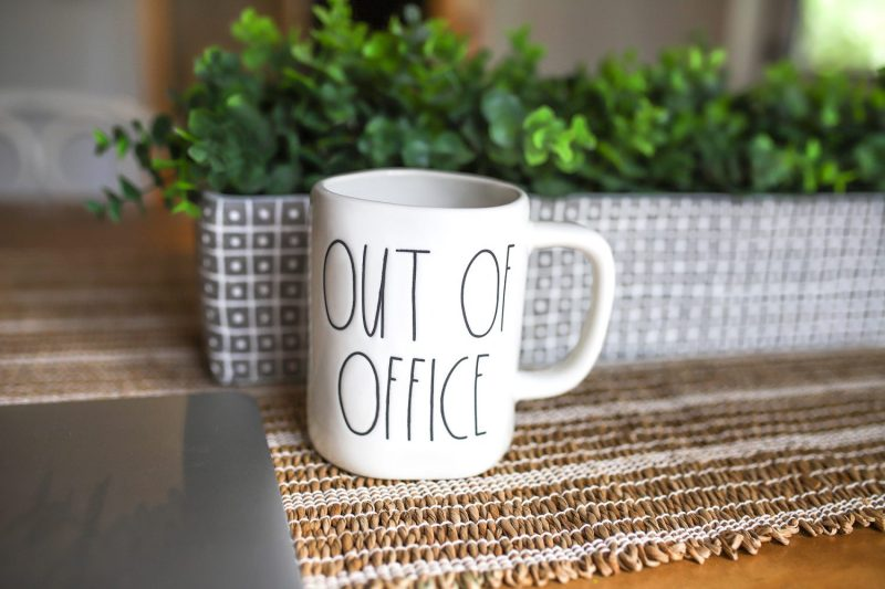 Rae Dunn Out of Office Mug on the kitchen table of an AirBnB