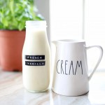 homemade french vanilla creamer next to a rae dunn cream pitcher