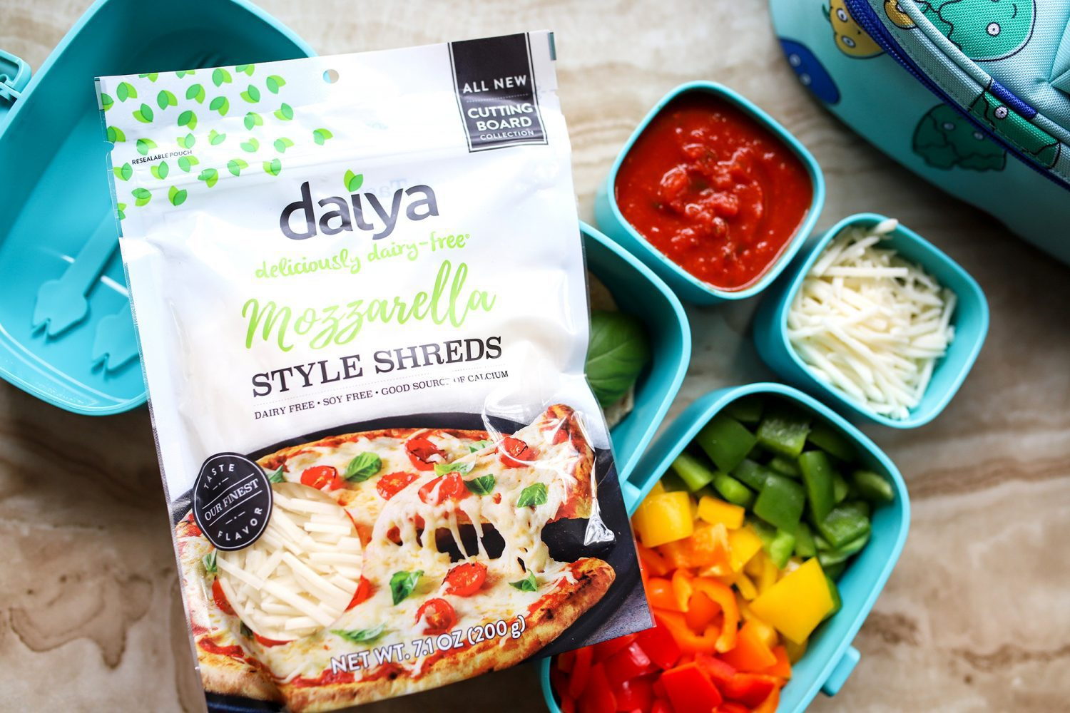 ingredients needed to make a dairy free pizza including daiya plant based cheese