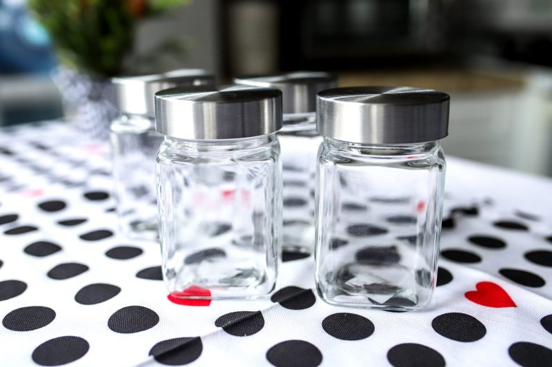 empty jars on a polka dot table cloth