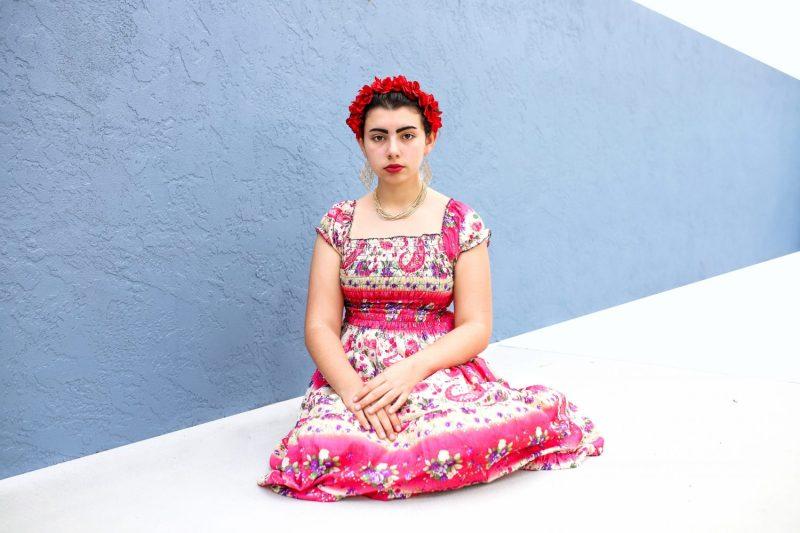 teenage girl dressed up in a frida kahlo costume