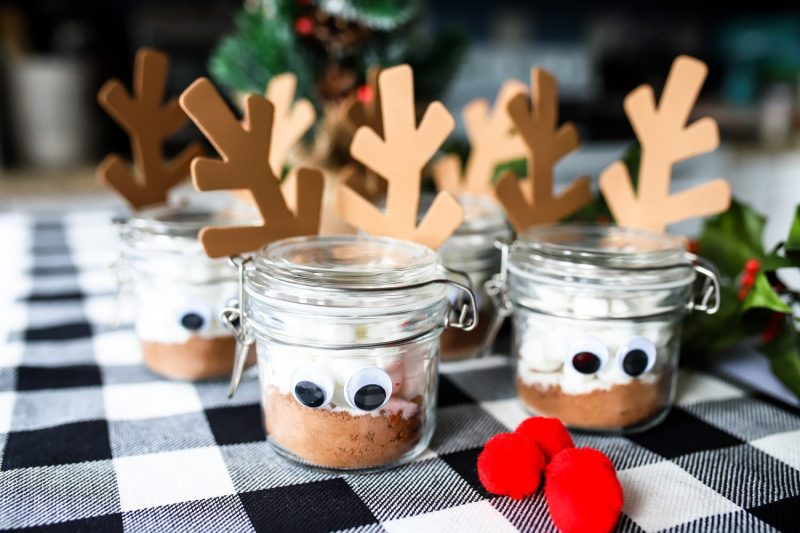 jars filled with hot cocoa with googly eyes and reindeer antlers