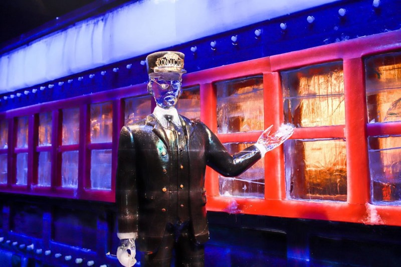 Conductor in front of The Polar Express