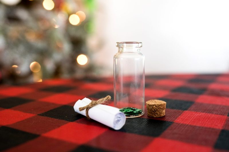 rolled up paper with tiny jar and cork