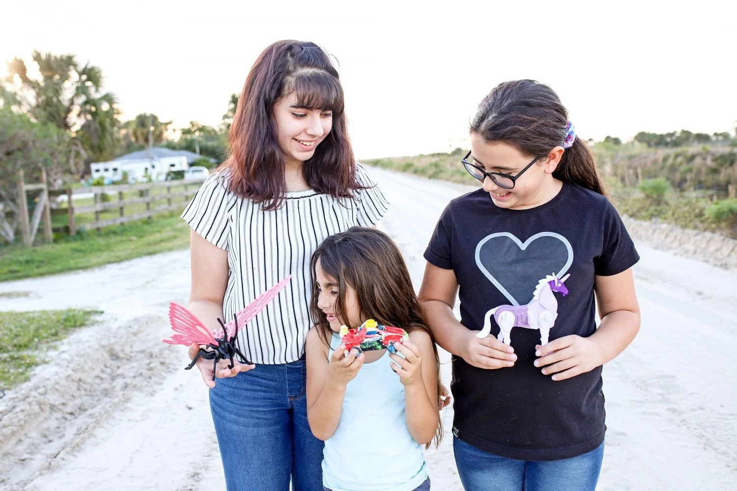 three girls displaying their reality puzzles