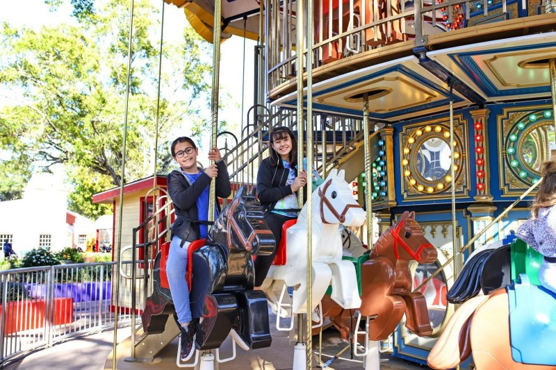 sisters on a carousel