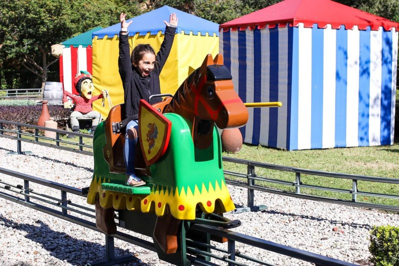 girl having a blast on a jousting ride