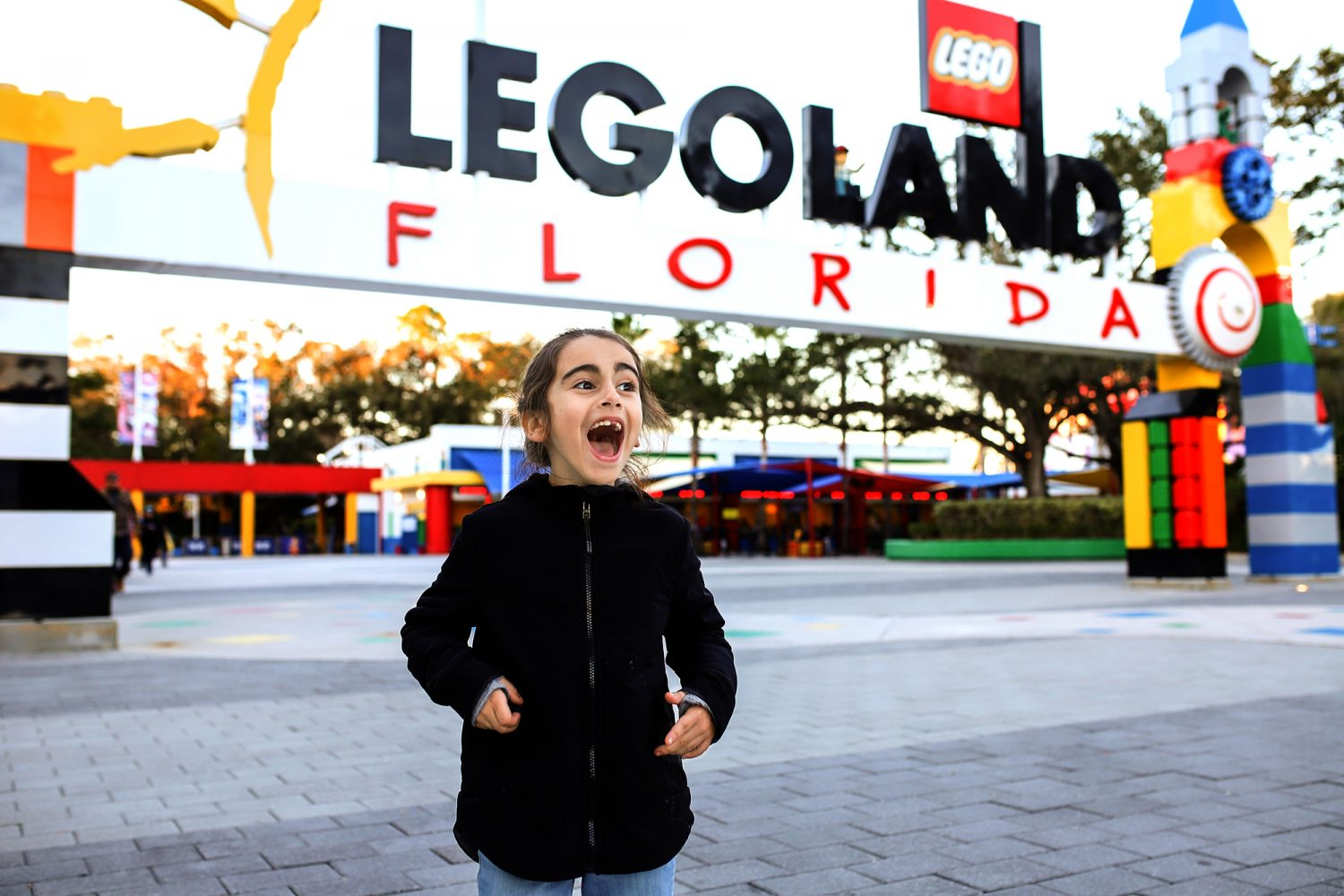 girl standing at the entrance of legoland florida
