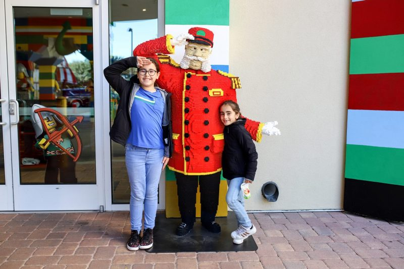 Two girls standing outside of the Legoland Hotel