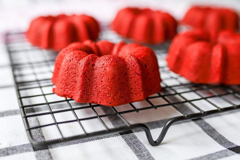 red velvet donuts on a cooling rack