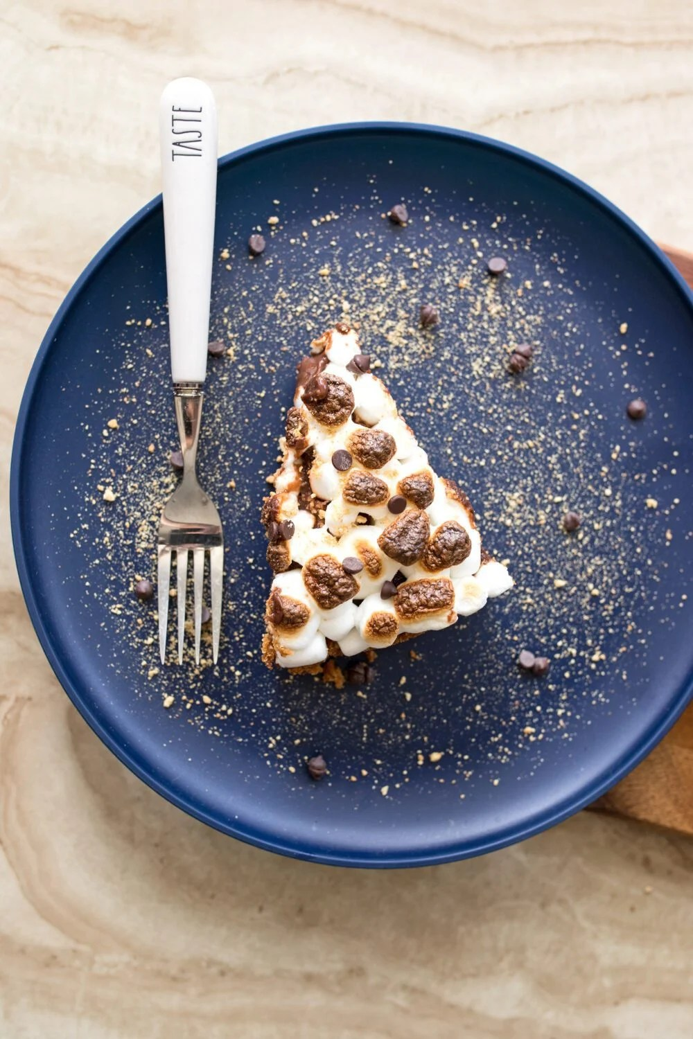 piece of s'mores pudding pie on a plate with a fork