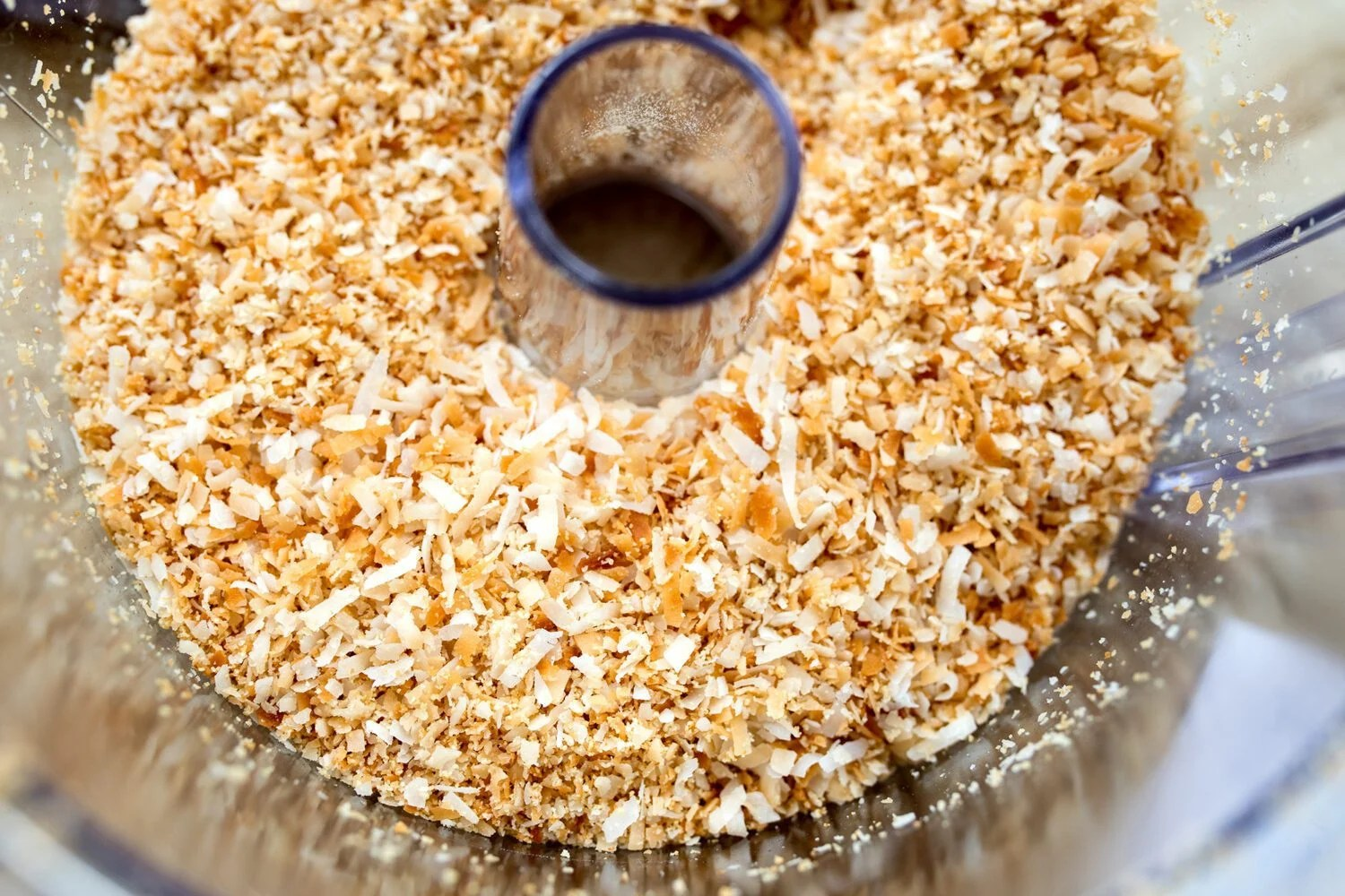 toasted coconut in a food processor