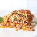 slice of super meaty and cheesy lasagna