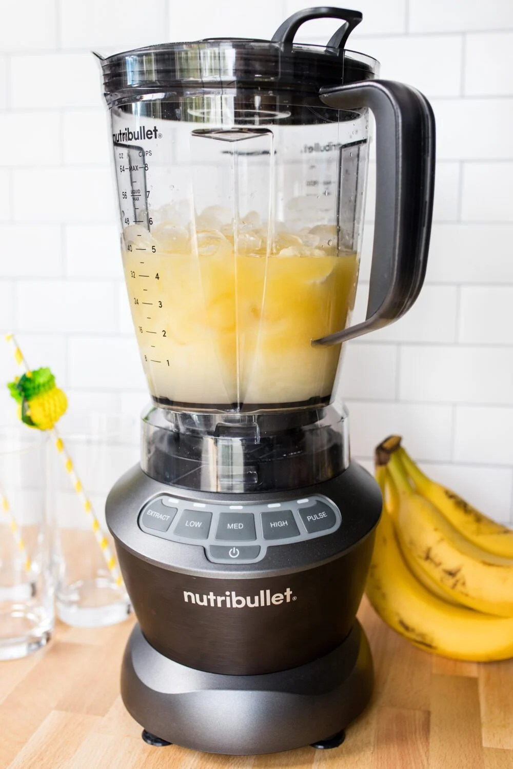 banana, pineapple juice, cream of coconut and ice in a nutribullet blender