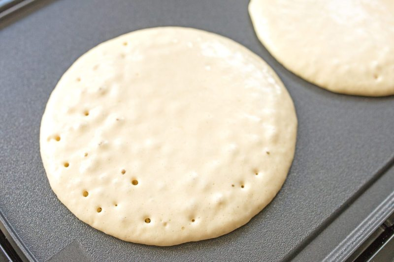 pancake batter on a griddle
