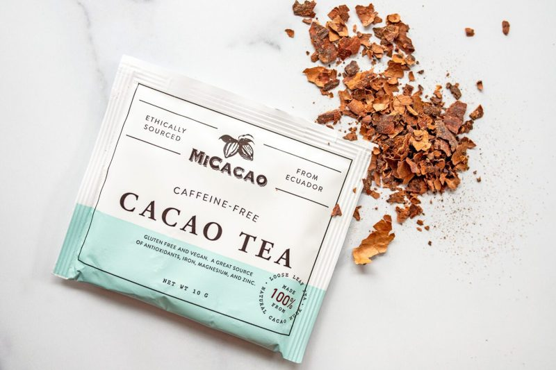 MiCacao tea leaves aside a sample package