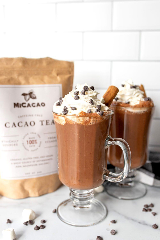 two mugs full of vegan chai hot chocolate