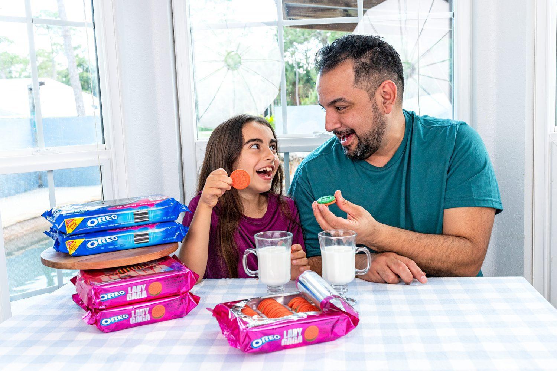 little girl and her dad enjoying Lady Gaga OREO Cookies