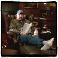Bobby reading sTORI Telling and drinking scotch