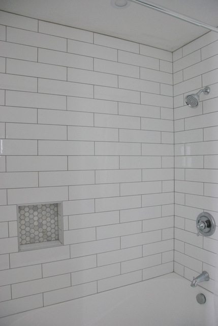 subway tile and marble tile niche