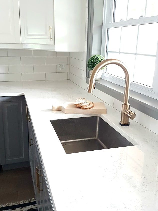 a gold kitchen faucet by delta