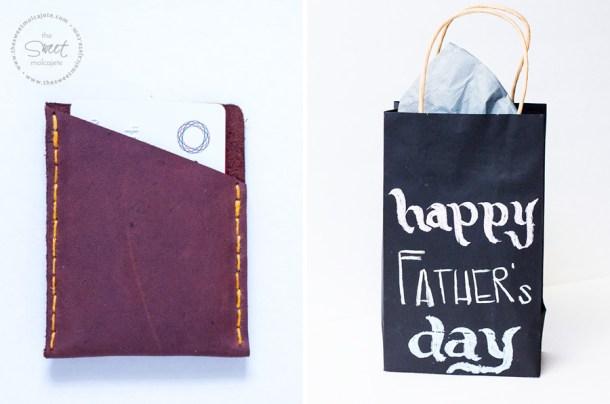 Cartera de piel para regalar el dia del padre junto con una bolsa de regalo negra que dice happy father's day