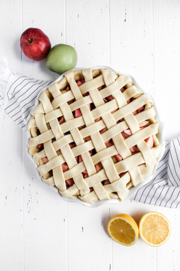 Unbaked blueberry apple pie with a lattice crust
