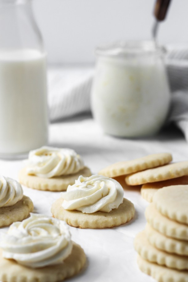 Round cut-out lemon butter cookies with a swirl of lemon buttercream