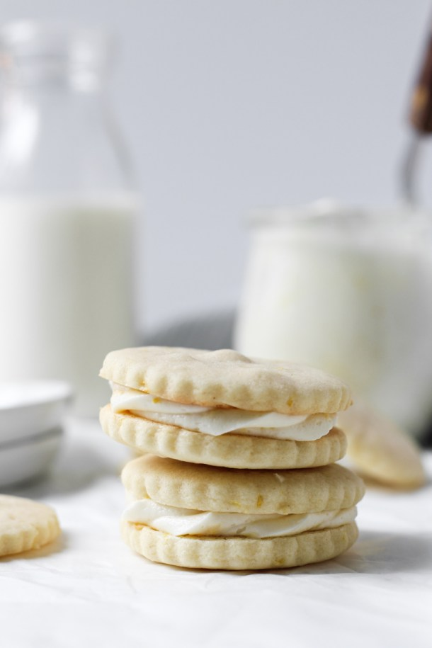 Stack of two lemon butter cookies sandwiched together with lemon buttercream.