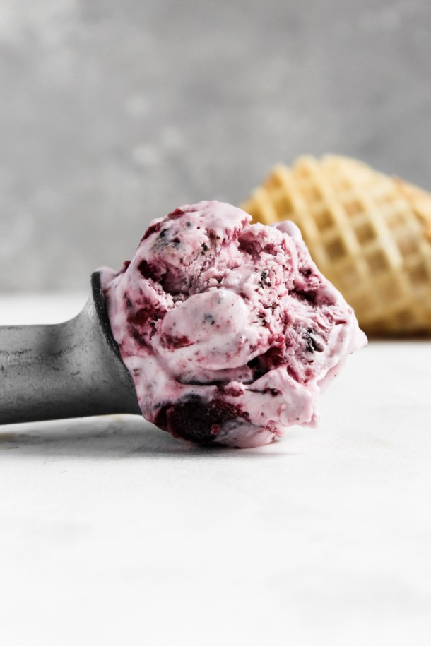 Scoop of no churn cherry chocolate chunk ice cream