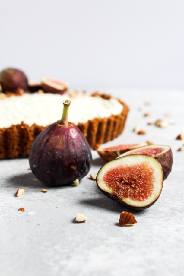 Fresh fig slices with a no-bake honey mascarpone fig tart in the background.