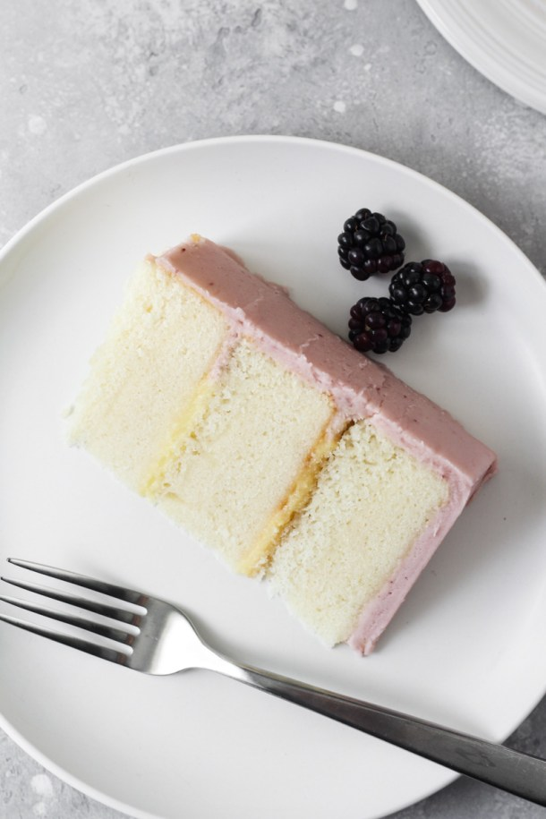Slice of blackberry lemon cake on a plate
