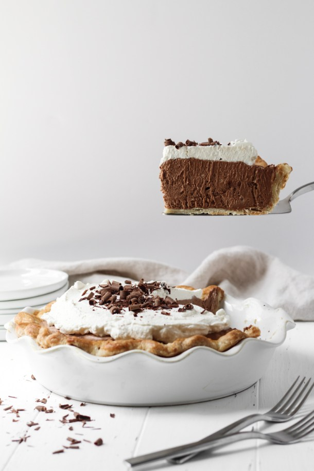 Slice of French silk pie hovering over the pie