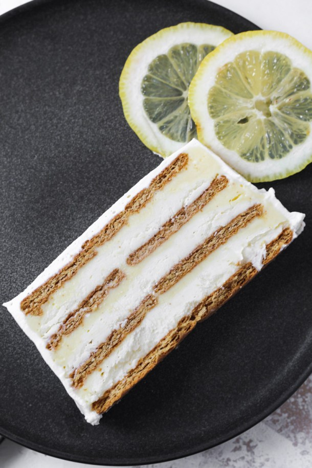 Slice of lemon icebox cake with layers showing