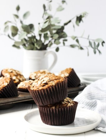 Stack of two banana muffins in a small plate.