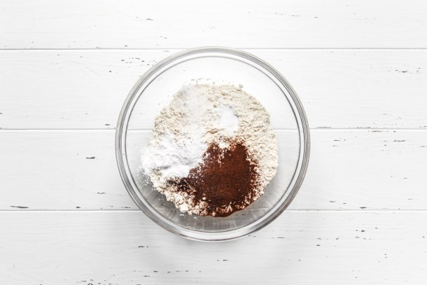 Dry ingredients in a glass mixing bowl for coffee cupcake batter.