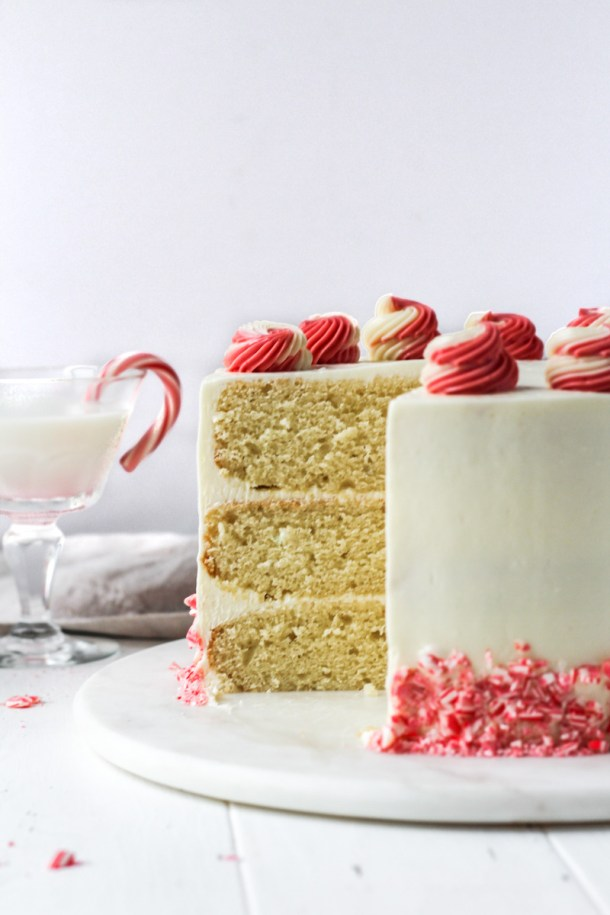 Peppermint flavored cake with slice missing to reveal the three layer cake's interior.