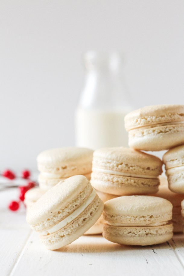 Stack of white chocolate cranberry macarons.