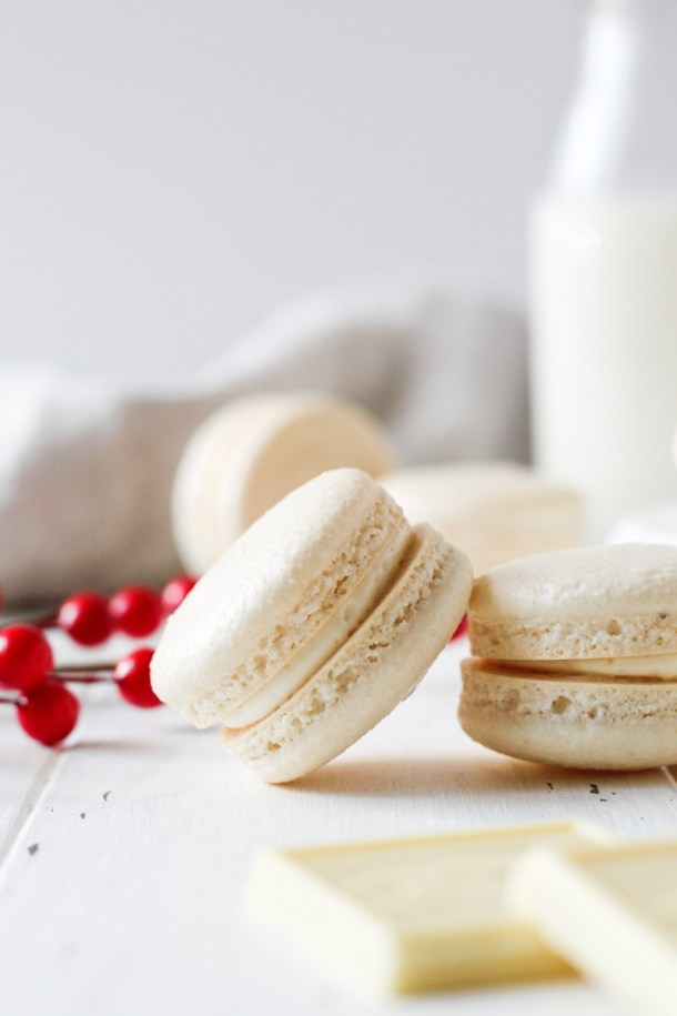 Close of two French macarons filled with cranberry sauce and white chocolate Swiss meringue buttercream.