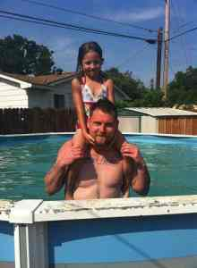 Ben and Samera at a friend's pool party