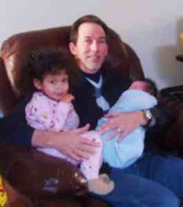 Frank with his two grandchildren, Ember and Coda