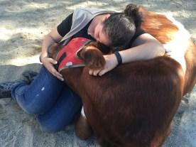 Volunteer Val cuddles with sweet Sage.