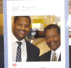 Mr. Alvin Pressley, principal (left), shows Dr. Ronald Rhames, MTC president (right), pose for a photo.