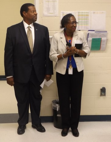 Dr. Ronald Rhames, MTC president (left), and Ms. Henrietta Montgomery , assistant principal (right), take a look at a class.