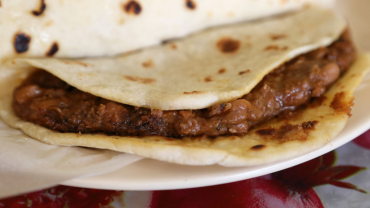 A regular bean and chorizo taco