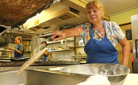Delores Mendez, owner of Mendez Cafe, tosses a tortilla into a pan. Brianna Rodrigue / Special to The Tacoist