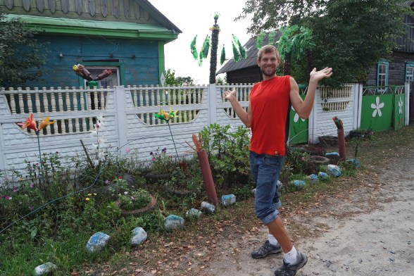 Ben posing in front of a house in Belarus