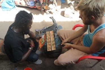 two man playing African board game