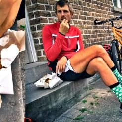 Bicycle rider eating Belgium french fries